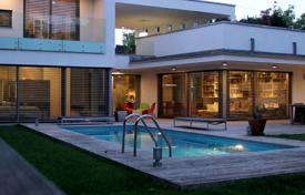 Houses with pools for sale in Budapest. Modern house with a swimming pool, terraces and a barbecue, in the elite 12th district of Budapest