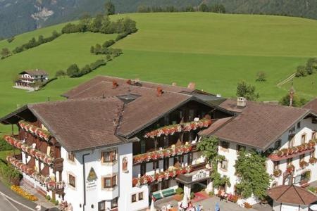 Hotels for sale in Austria. Beautiful hotel in a traditional Tyrolean style in a beautiful location in Thiersee