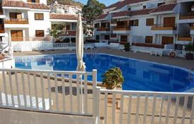 Coastal residential for sale in Tenerife. The furnished duplex with a large terrace, in a residential complex with swimming pool, 150 m from the beach, in Los Cristianos, Tenerife