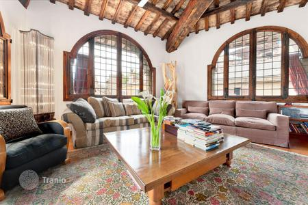 Luxury residential for sale in Italy. Extraordinary attic with small private terrace in a 15th century historic building
