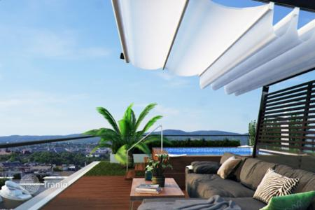2 bedroom apartments for sale in Vienna. Penthouse with a rooftop terrace and a Jacuzzi with views over the rooftops of Vienna houses, Austria