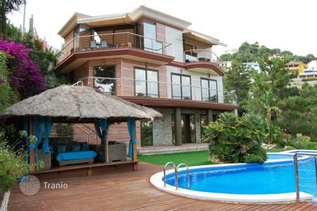 Luxury houses for sale in Costa Brava. Designer villa with pool, garden and stunning views of the sea in Lloret de Mar