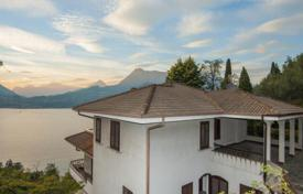 6 bedroom houses for sale in Lake Como. Comfortable villa with terrace, garden and stunning views of Lake, Perledo, Italy