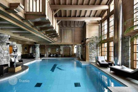 Villas and houses for rent with swimming pools in Auvergne-Rhône-Alpes. New chalet with a swimming pool and spa area in a luxury ski resort of Courchevel 1850, France
