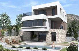 3 bedroom houses for sale in Dalmatia. Modern villa with a private garden, a swimming pool, a garage and a sea view, Trogir, Croatia