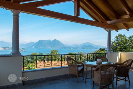 Coastal residential for sale in Piedmont. New duplex apartment with its own entrance, a garage and a terrace with panoramic views of the lake in Baveno, Italy