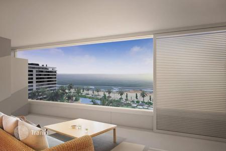 New homes for sale in Costa Blanca. Apartment in a new residence, with garden and swimming pool, on the first sea line, in Punta Prima, Alicante, Costa Blanca, Spain