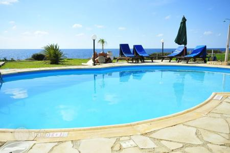 Luxury residential for sale in Cyprus. Villa with pool and large plot of land, on the sea shore, near the Sea Caves, Paphos, Cyprus