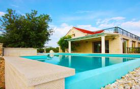 Houses with pools by the sea for sale in Split-Dalmatia County. Premium class villa with swimming pool, relaxation area and views of the sea in the village of Sutivan, island of Brac
