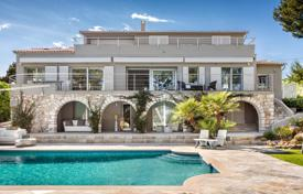 Luxury 5 bedroom houses for sale in Saint-Jean-Cap-Ferrat. Modern villa with a large plot of land, a swimming pool, an elevator and a garden, in the center of Cap Ferra, France