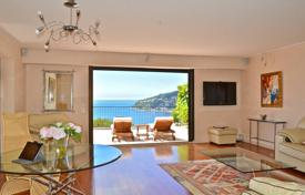 Luxury apartments with pools for sale in Côte d'Azur (French Riviera). Luxury apartment-villa with terraces and a sea view in a residence with a concierge and a swimming pool, Villefranche-sur-Mer, France