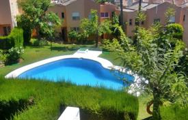Townhouses for sale in Costa del Sol. Townhouse with a private garden, a parking, a terrace with sea and mountain views, Estepona, Spain