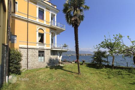 Luxury residential for sale in Italy. The ancient villa with its own dock, a terrace and a garage, on the shore of Lake Maggiore in Baveno, Italy