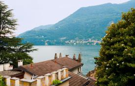 4 bedroom apartments for sale in Lombardy. Two-level lakeview apartment with a private garden, a parking and a mooring in a prestigious residence, Torno, Italy