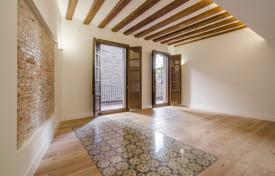 Penthouses for sale in Catalonia. Two-level penthouse with a balcony and a terrace, in a historic four-story building, in the center of Barcelona, Spain