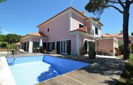 Houses with pools for sale in Lisbon. Villa with mountain views in a luxury condominium in the village of Areia, Cascais