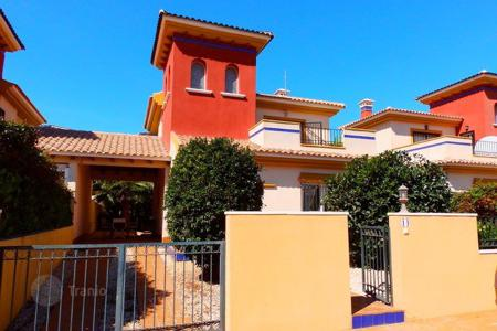 Houses with pools for sale in Dehesa de Campoamor. 3 bedroom detached villa with big terrace in a complex with pool in Cabo Roig