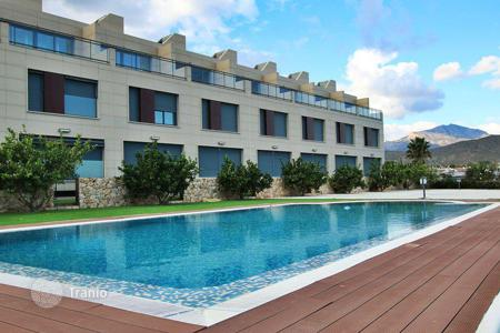 Residential from developers for sale in Valencia. Townhouse in a new residence with swimming pool, 100 meters from the sea, in Campello, Alicante, Spain. 50% discount from the builder!