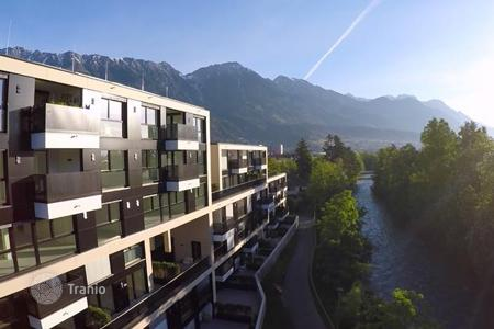 New homes for sale in Tyrol. Modern apartment with a terrace, with spectacular views of the mountains and the park, in the new house, Innsbruck, Austria