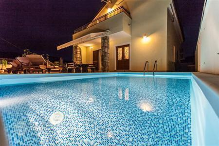 Houses with pools for sale in Crikvenica. Luxury villa with the view of the lake Tribalj