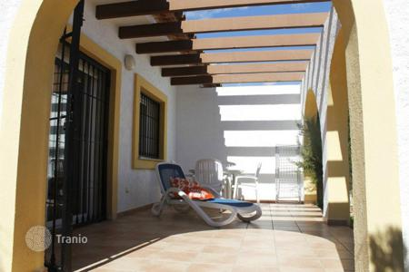 Townhouses for sale in Calpe. Semi-Detached Villa of 3 bedrooms in a complex with pool and gardens in Calpe