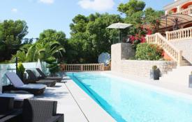 Luxury houses for sale in Majorca (Mallorca). Spacious villa with a swimming pool, a terrace, a garage and a sea view, Costa D'en Blanes, Spain
