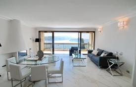 Apartments with pools by the sea for sale in France. Modern two-bedroom apartment with a terrace, in a residential complex with a swimming pool and a garden, Villefranche-sur-Mer, France