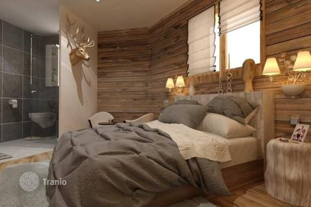 Cheap new homes for sale in France. Cozy three-room apartment in new a building in the ski resort of Morzine, Haute-Savoie, France