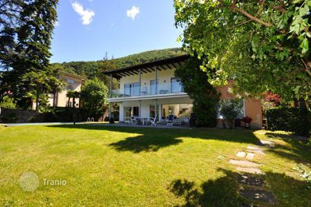 Villas and houses with pools to rent in Ticino. Luxury villa with a pier on Lake Lugano, Bissone, Switzerland