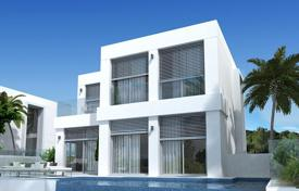 Houses with pools for sale in Guardamar del Segura. The new two-storey villa with panoramic windows, a swimming pool and a spacious terrace with sea view, Guardamar de Segura, Alicante, Spain