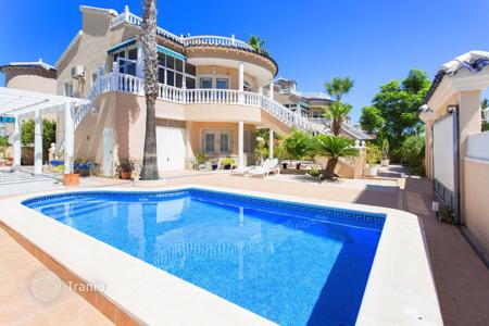 Houses with pools for sale in Costa Blanca. Two-level villa with a pool, a garden and a sea view in Torrevieja, Los Altos area