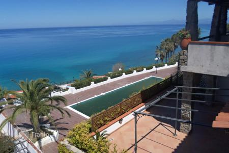 Apartments with pools by the sea for sale in Italy. Apartment with large terrace and panoramic sea views, 100 meters from the private beach apartment complex in Parghelia