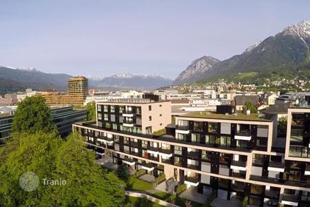 New homes for sale in Tyrol. Three-bedrooms apartment with terrace and balcony, overlooking the mountains and park, Innsbruck, Austria