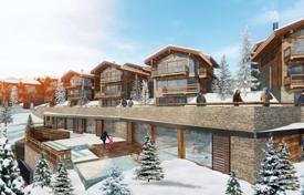 Houses with pools for sale in Auvergne-Rhône-Alpes. Spacious chalet with a terrace, balconies and bay windows, next to the ski slopes, in the resort village of Courchevel, Alpes, France