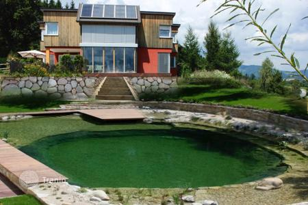 Property for sale in Carinthia. House with wonderful views, an orchard, and the possibility of breeding horses, Carinthia