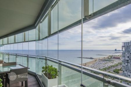 Luxury apartments for sale in Spain. Designer apartment in Barcelona, Spain. Flat with a large terrace, in a beachfront residence with a garden and a swimming pool, Barcelona