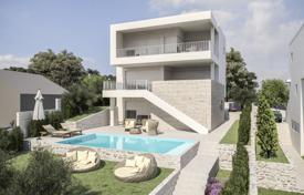 Houses with pools for sale in Rogoznica. Modern villa with a private garden, a pool, a garage and a sea view, Rogoznica, Croatia