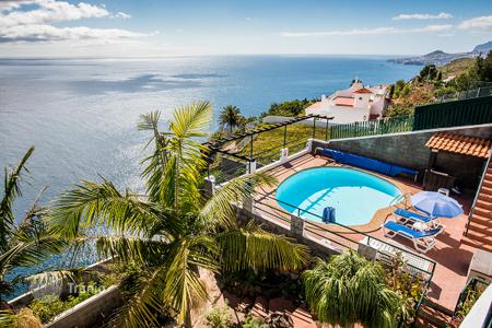 Property for sale in Madeira. Magnificent, ocean front, detached villa with heated swimming pool!