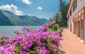 Luxury houses for sale in Apulia. Three-storey villa on Lake Lugano with a private promenade, a dock, a garden and a garage near the Swiss border, Oria, Italy