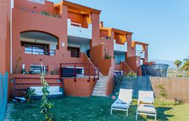 Townhouses for sale in Andalusia. Modern town house with a garden, a garage, a terrace and sea and mountain views in a complex with swimming pools, Benahavis, Spain