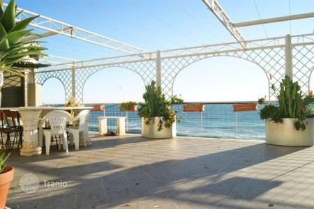 Penthouses for sale in Ospedaletti. Penthouse with a spacious terrace, at two meters from the sea, Ospedaletti, Italy