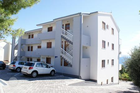 1 bedroom apartments by the sea for sale in Croatia. Apartment with panoramic views, 100 meters from the beach in Busintsi on the island of Ciovo