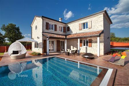 Houses with pools for sale in Beram. Modern Mediterranean style villa with sea views in Istria, Croatia