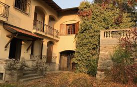 5 bedroom houses for sale in Piedmont. Comfortable villa with a terrace and a huge garden, Arona, Piedmont, Italy
