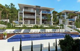 New homes for sale in Catalonia. Modern apartment with a terrace and a garden, in a new residential complex with a pool, Castell Platja d'Aro, Spain