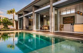 Property for sale in Bali. Modern furnished villa with a private plot and a terrace in a secured complex with a parking, near the beach, Seminyak, Bali