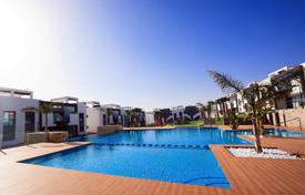Apartments with pools for sale in Guardamar del Segura. New apartments in a residential complex near the park and the lake in El Raso, Alicante, Spain