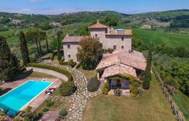Luxury houses for sale in Umbria. Exclusive 14th century villa with a pool, a garden and stunning panoramic views, Todi, Italy