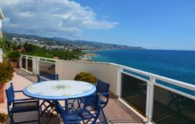 Coastal penthouses for sale in Liguria. Penthouse with terrace and beautiful view of the sea, in complex with private beach and parking on the first line, San Remo, Liguria, Italy