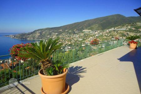 6 bedroom houses for sale in Liguria. Three-storey villa on a rise, with a garden and a bay view, in a quiet district of Ospedaletti, Italy
